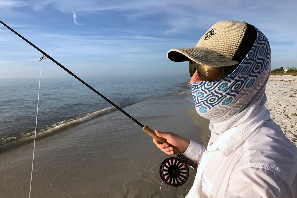 Scott wearing the first Happier Bandana and the Happier Place Burlap Trucker Hat while fly-fishing in Clearwater Beach, Florida.