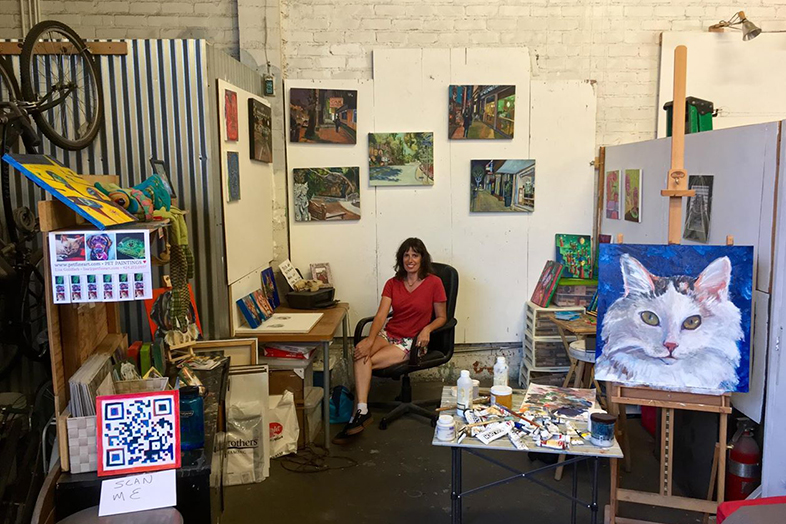Lisa Goldfarb in her painting studio in California. Happier Place