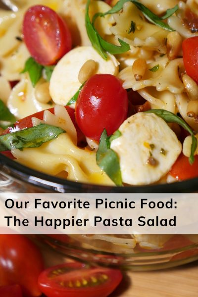 Happier Place favorite picnic food: Happier Pasta Salad recipe features tomatoes, mini mozzarella, sun-dried tomatoes and toasted pine nuts.