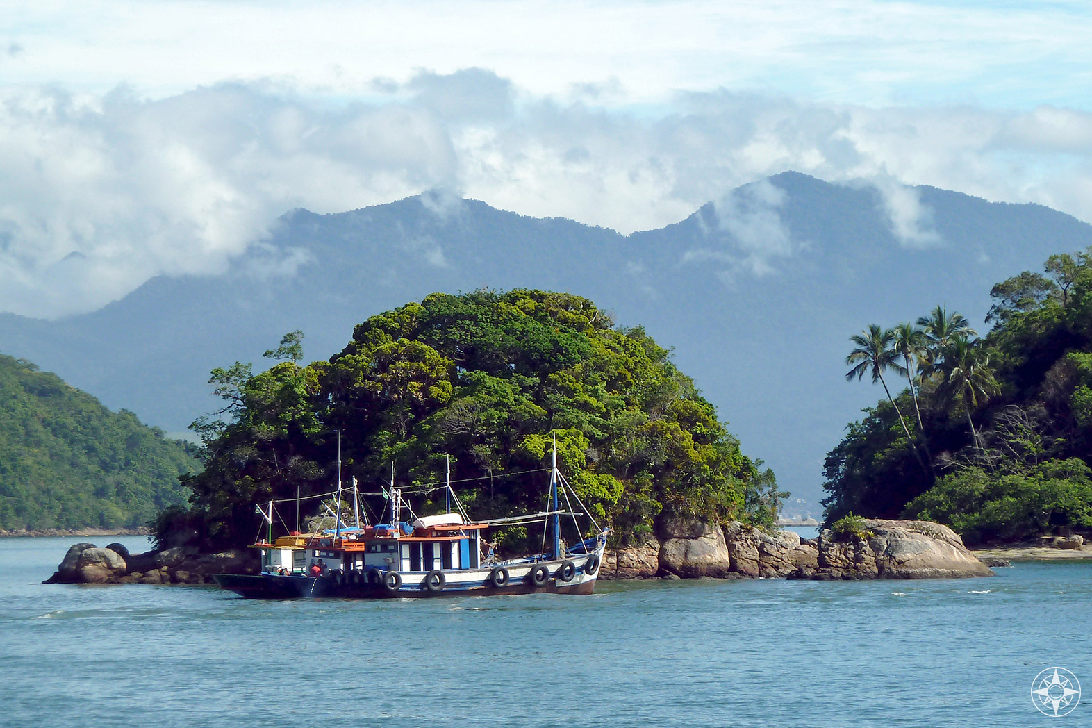 Fishing boats off Paradise island Ilha Grande in Brazil - Happier Place