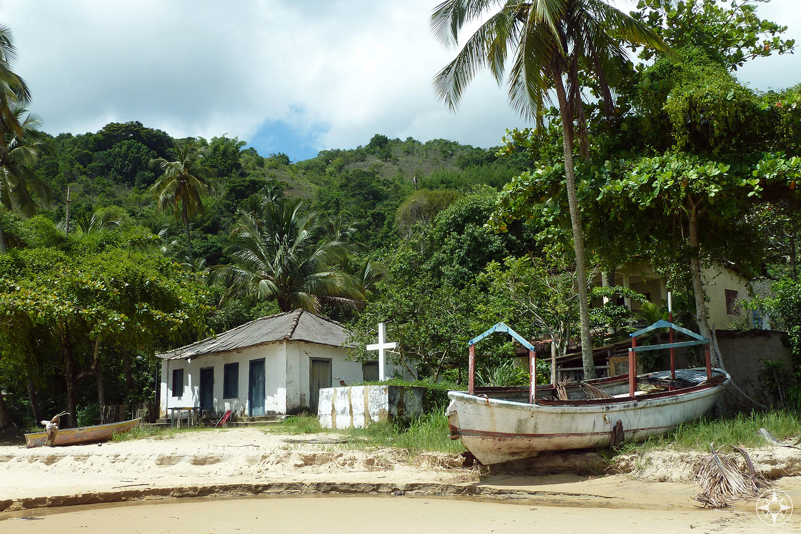 House, cross, boat on a beach - things you find along the jungle-and-beach trail between Vila do Abraão and famous Lopes Mendes beach. HappierPlace