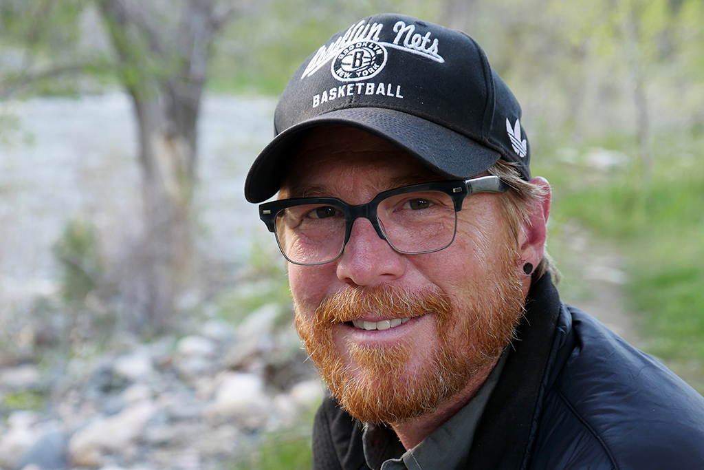 Scott Solary of Happier Place - wearing Brooklyn Nets cap at the Poudre River in Colorado