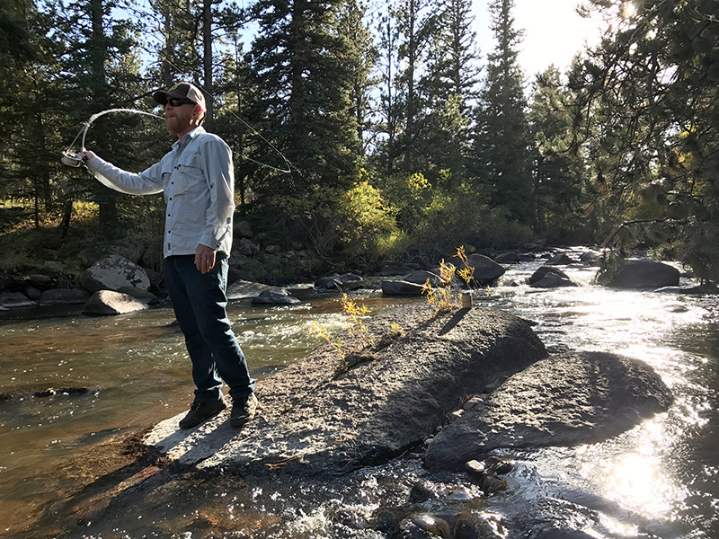 Scott Solary fly-fishing the North Fork of the Cache la Poudre River in Colorado.