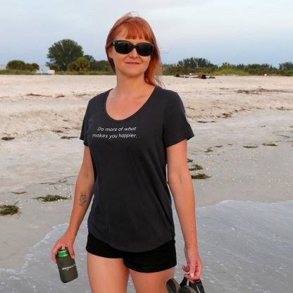 "The ""Do more of what makes you happier"" T-shirt on the beach in Florida at sunset. Happier Place - H011-TSH-HA-GY"