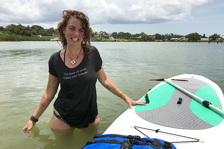 Margo and her SUP visiting the new Happier Place headquarters in Florida.
