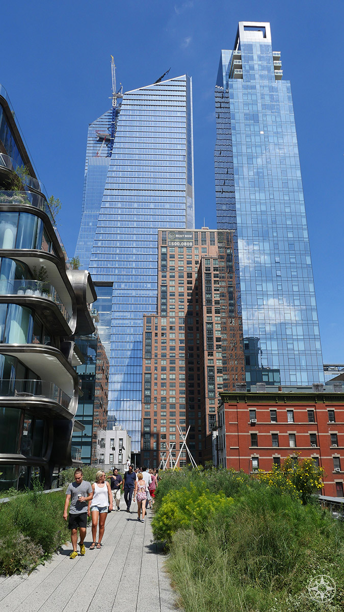 The high rises of the Hudson Yards are still under construction - but already loom tall over the High Line.