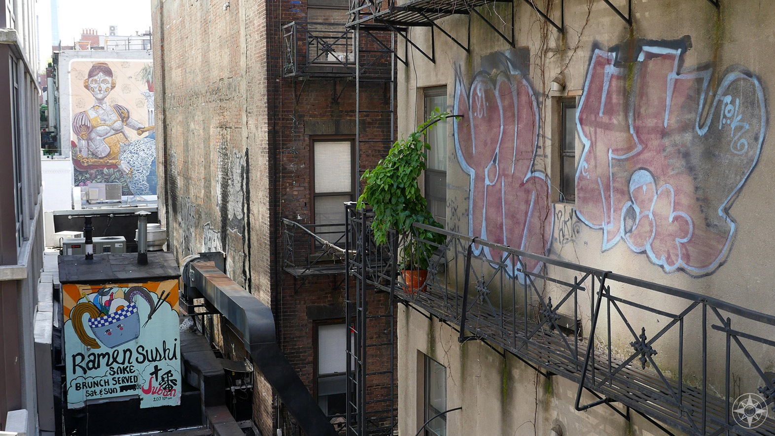 Seen from the High Line: Ramen, female robot, street art, fire escape, plant.