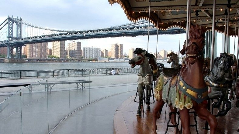Jane's Carousel in DUMBO, the Manhattan Bridge and the Lower Eastside in Manhattan. Happier Place