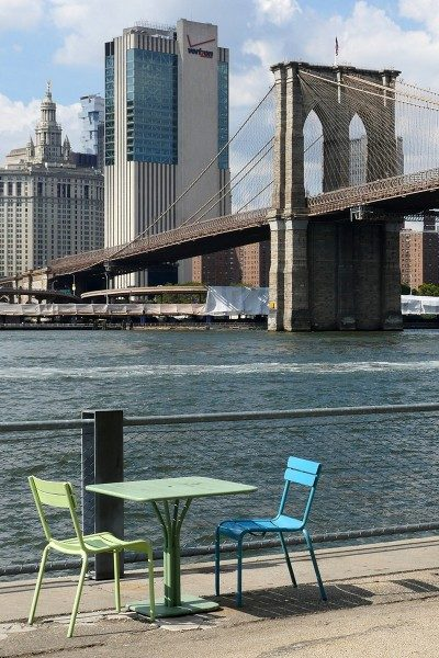 Table and chairs on Pier 1 of Brooklyn Bridge Park on the East River.