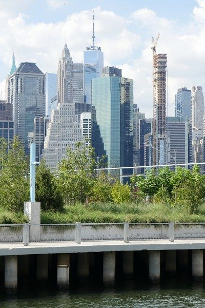 Pier 3 features a green parkland that seems suspended between the East River below and the Manhattan skyline above (including One World Trade Center, the tallest building in the Western Hemisphere).