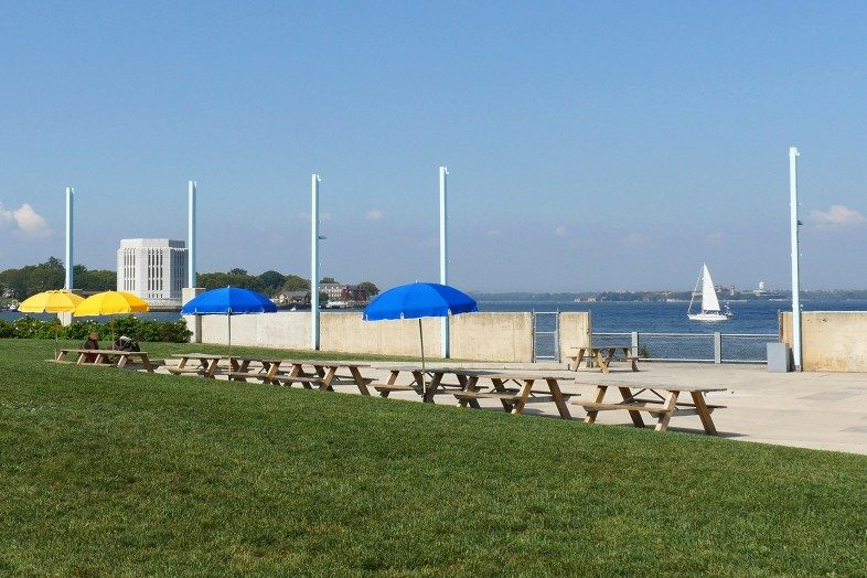 The Brooklyn park offers plenty of places to sit and relax while watching the boats go by on the East River.