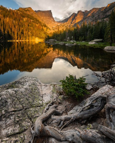 Mountain sunrise reflected in alpine lake in Rocky Mountains. Photo by Bryan Clark. Happier Place