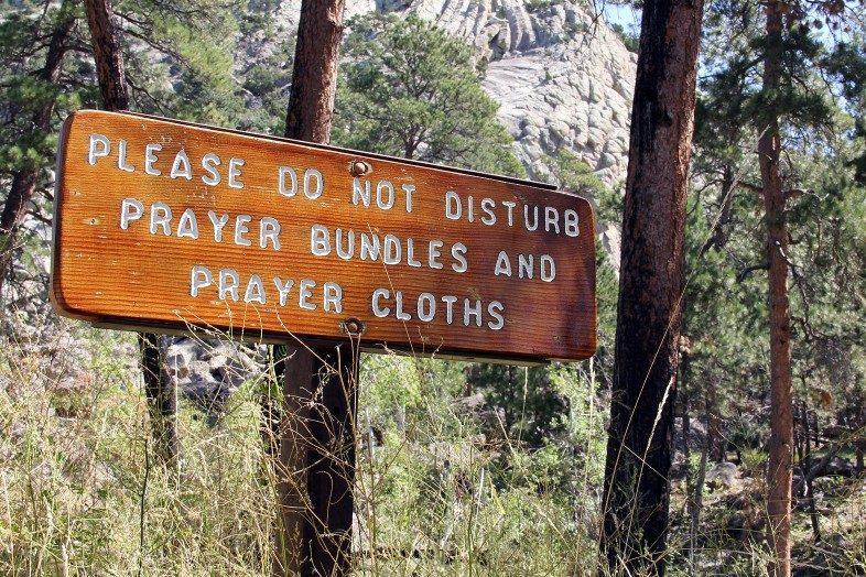 Sign at Devils Tower / Bear Lodge: please do not disturb prayer bundles and prayer cloths.