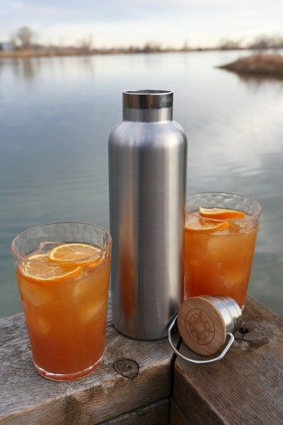 Rye Amaretto Cider Happier Holidays Cocktail and Happier Place Insulated Stainless Steel Bottle at the Riverbend Ponds in Ft. Collins, Colorado.