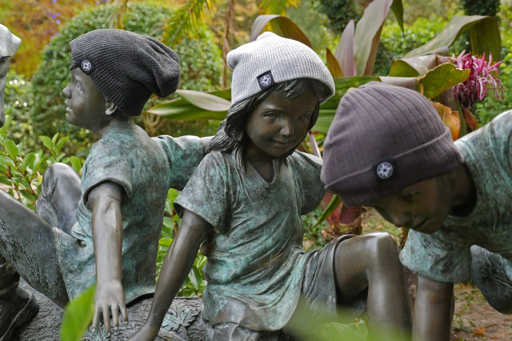 Happier Place Beanies - classic beanie and slouchy beanie - children sculpture Largo Central Park Florida