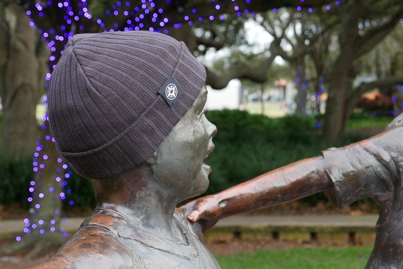 Happier Place Rib Classic Cuffed Beanie on child sculpture in Florida