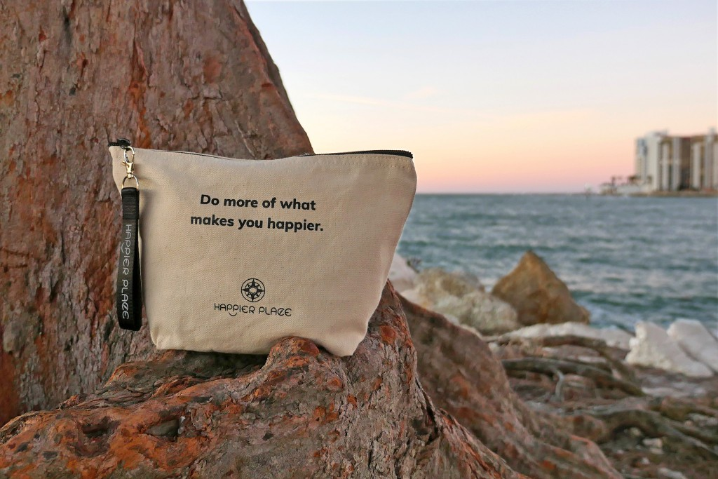 Do more of what makes you happier bag on a tree at Clearwater Beach during sunset