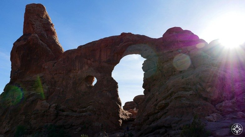 Turret Arch photographed against the sun.