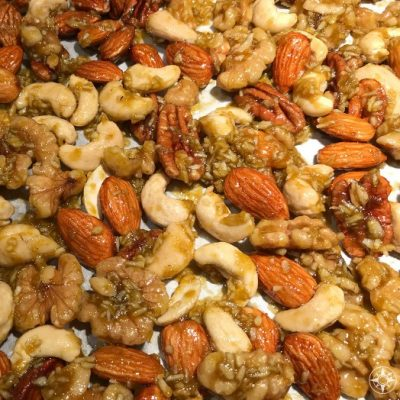 The Crack Nuts mix in all its curried honey gooeyness before all the roasting magic.