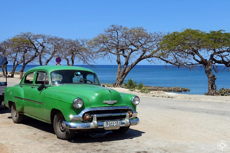 Green classic car on the waterfront in Cuba. La Boca