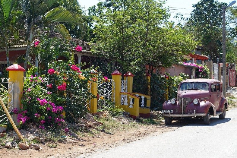 Colorful homes, abundant flowers and classic cars are typical for Cuban villages.