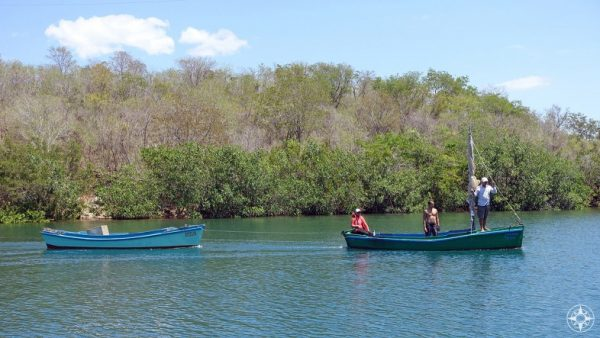 Small fishing boats coming in from the sea into the Rio Guaurabo.