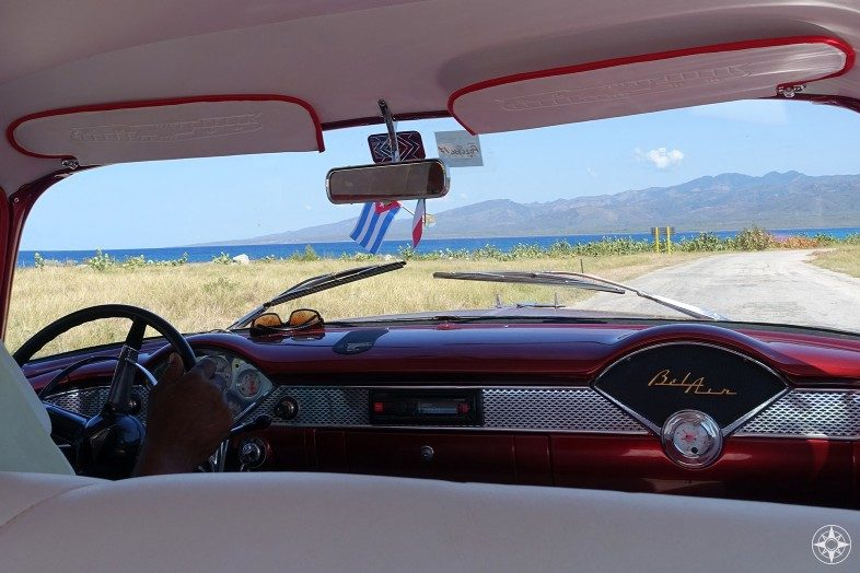 View from a Cuban BelAir classic car taxi of the drive from Playa Ancon to La Boca along the Caribbean Coast.