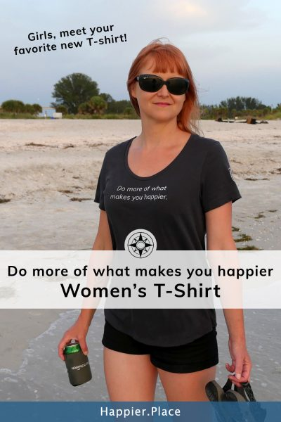 Do more of what makes you happier T-Shirt on the beach in Florida at sunset.