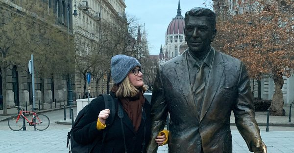Cheryl Howard and the Ronald Reagan statue in Budapest - Happier Place