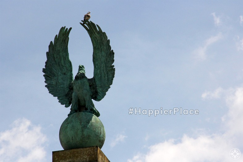 Pigeon sitting on eagle statue in Prospect Park Grand Army Plaza Brooklyn New York representing #HappierPlace