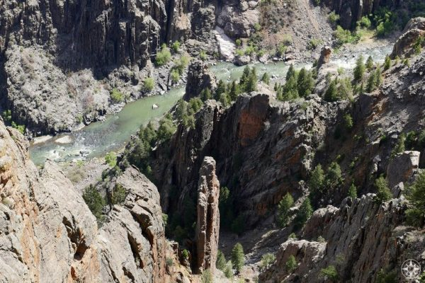 Tall spires and the rushing Gunnison River at the bottom of the Black Canyon
