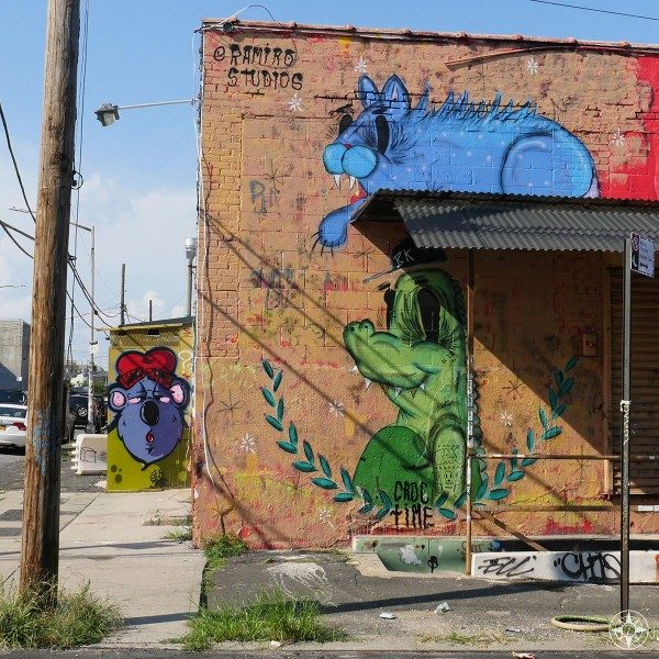 Blue Cat and Croc street art by Ramiro Studios (Ramiro Davaro-Comas) and a purple face down Waterbury Street, Brooklyn.