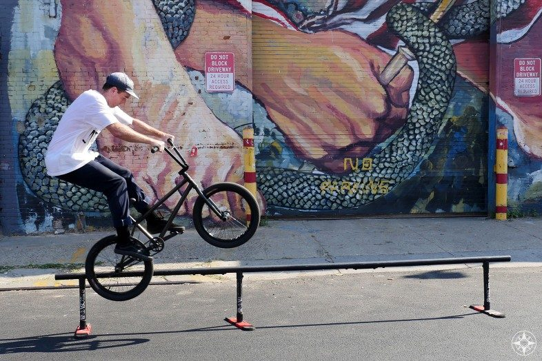 BMX bike snake hand mural Urban art by Ever Siempre Meserole