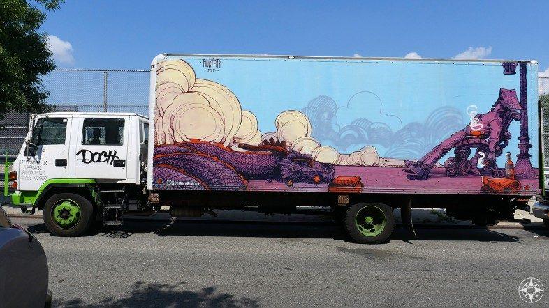 Sleeping reader and dragon urban art on truck by nubian art in Brooklyn NYC