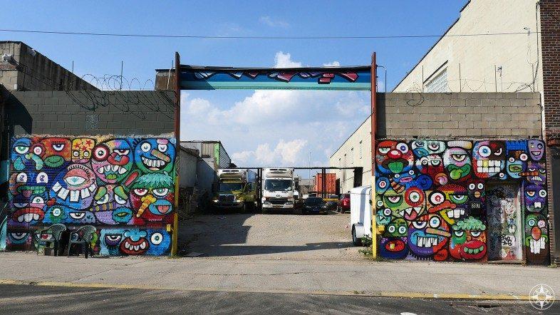 Colorful faces graffiti by Phetus Brooklyn street art