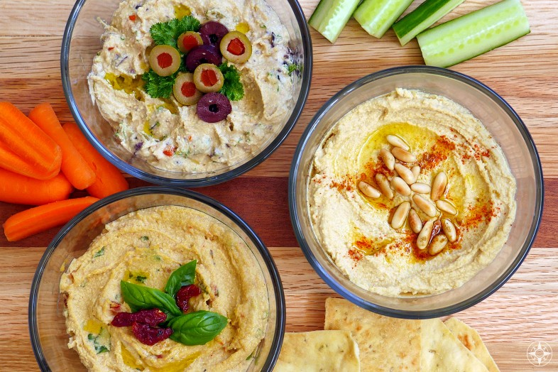 Homemade Hummus with olives sun-dried tomatoes pinenuts