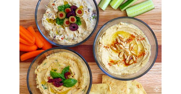 Homemade Hummus with olives sun-dried tomatoes pine nuts
