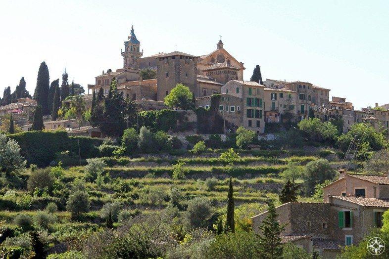 The Charterhouse Monastery of Valldemossa on a green hill on Mallorca.