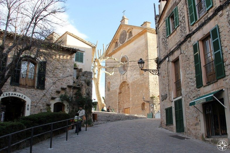 Historic buildings, churches and cobble stone streets in Valldemossa on the island Mallorca.