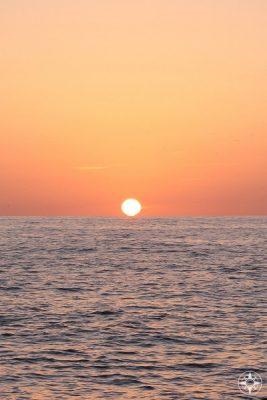 Sunset into the sea - seen perfectly from Port de Valldemossa on Mallorca.
