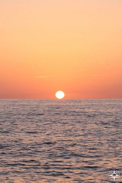 Sunset into the sea - seen perfectly from Port de Valldemossa on Mallorca, Spain.