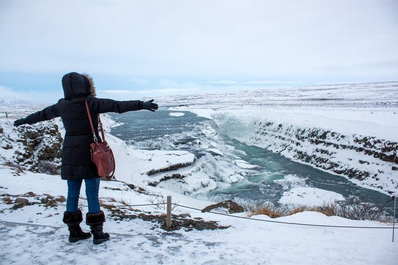 Travel blogger Cheryl Howard at the Gullfoss Waterfall in Iceland.
