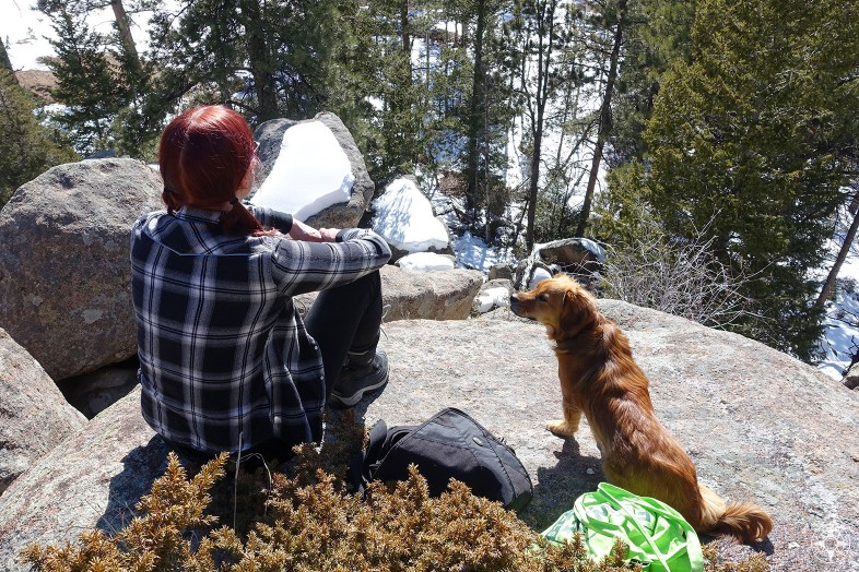 Having a Happier place with dog and woman in the mountains