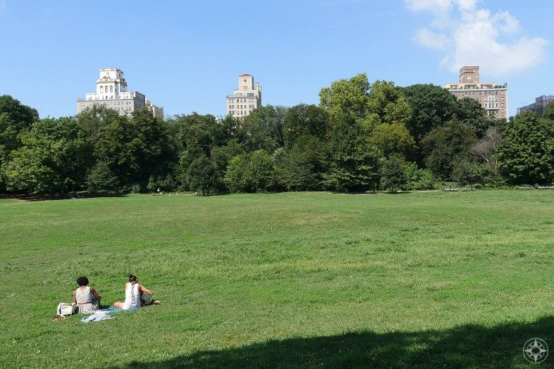 Two women are having a Happier Place in Prospect Park in Brooklyn, NY