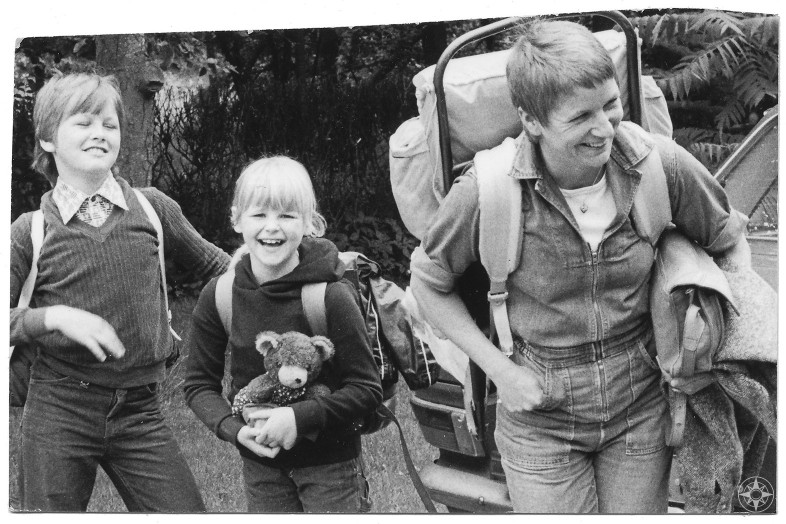 Take your kids outdoors - Happier Kids - Happier Place - Happier Family laughing backpacks