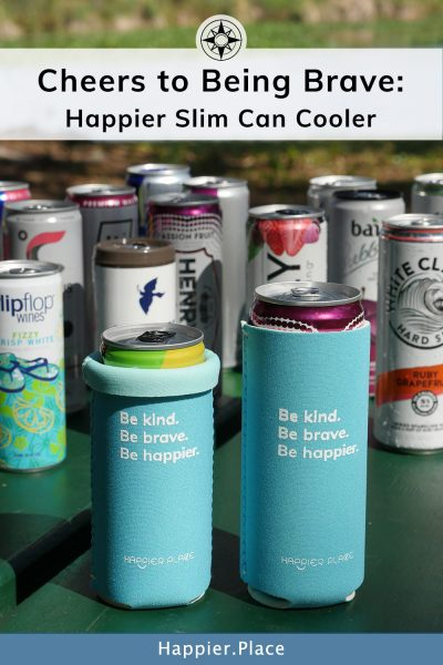 Cheers to being brave: the Happier Slim Can Cooler for cool drinks and for making the world a happier place with its inspirational quote.