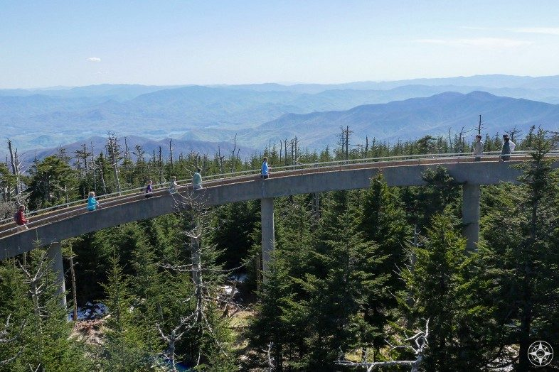 People hiking circular ramp up to Clingmans Dome Tower and the Smoky Mountains beyond