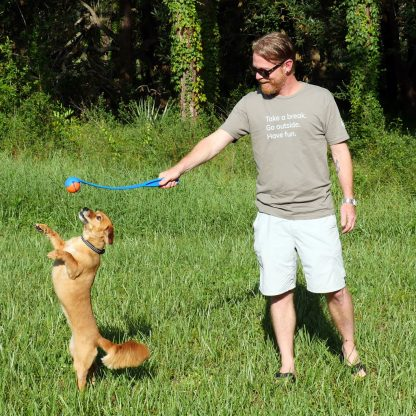 Whiskey dog playing with Scott wearing Take a Break Go Outside Have Fun Happier Place T-shirt