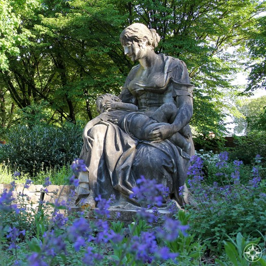 Mother statue among purple flowers in the Scent Garden