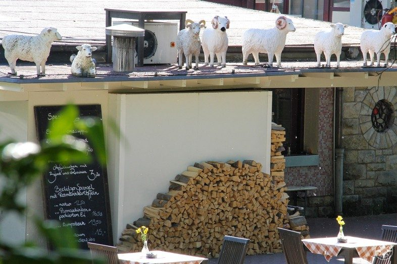 Sheep sculptures on the top of Berlin Restaurant Schoenbrunn